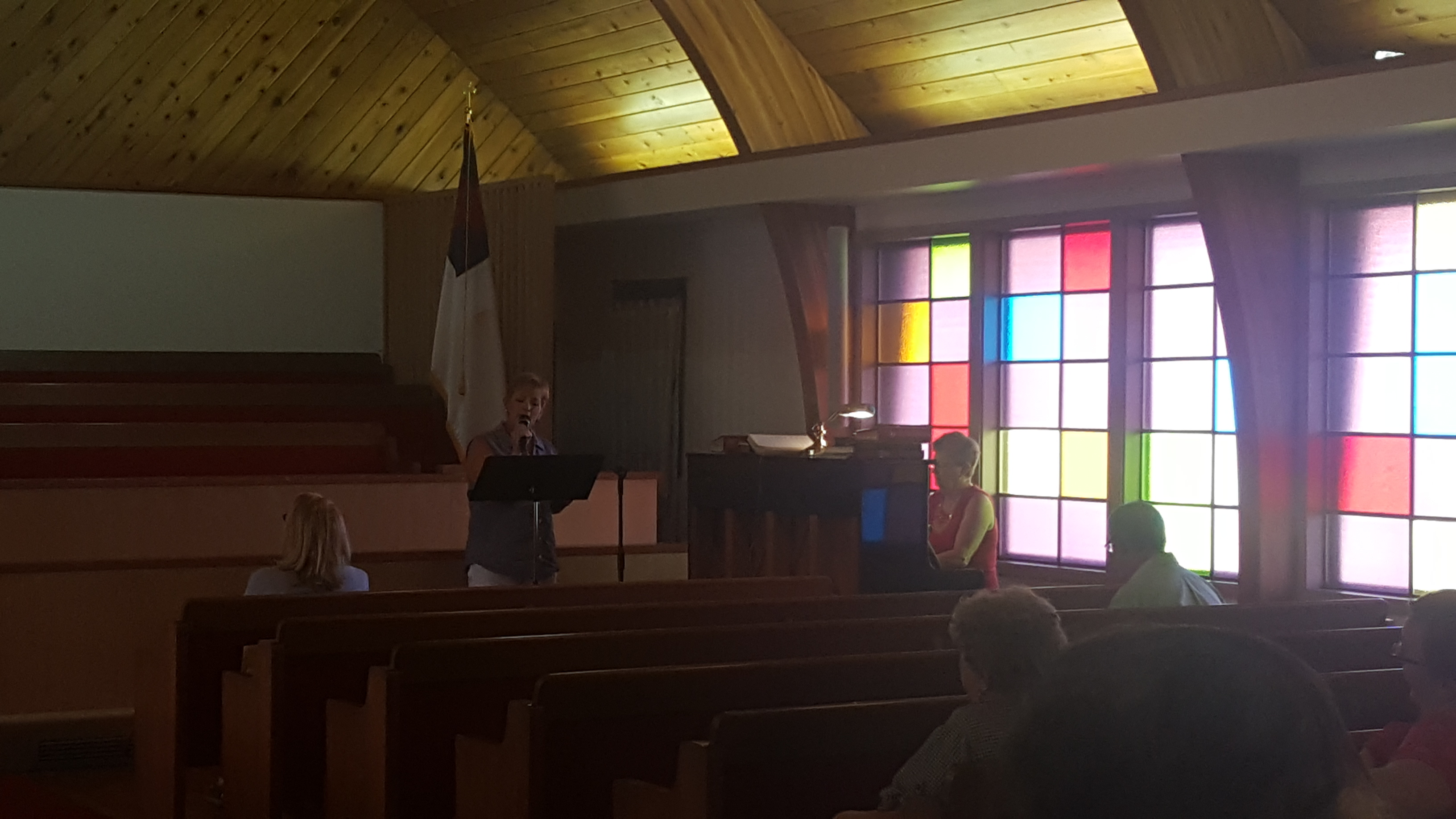 image of interior of Middleton UMC with singer and piano player